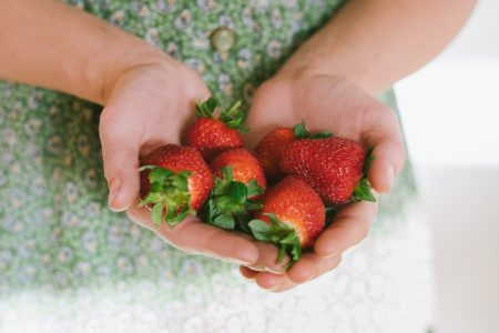 person-holding-strawberries-on-her-hands-361837072
